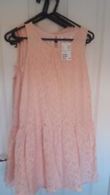 Peachy/pink coloured girls dresses-various sizes