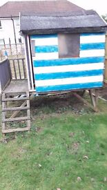 Wooden playhouse for sale needs new floor and tlc