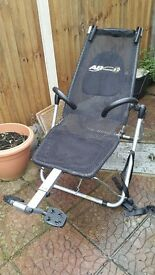 ab lounger machine ( chair) for ab workouts, takes less strain on your back .