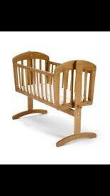 Natural wood swinging crib
