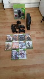 Microsoft Xbox 360 Slim 250 GB Glossy Black Console plus 2 controllers and 10 games