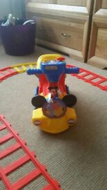 Micky mouse ride on train with track