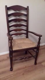 Ladder back arm chair with rushed seat