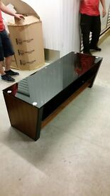 Dark wood TV cabinet with smoked glass top and middle shelf