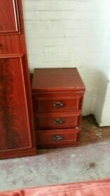Triple wardrobe set with matching bedside Units.