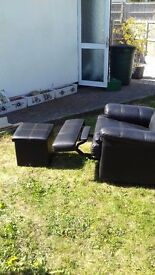 Pair of Leather recliners black in good condition with matching stool cubes with storage