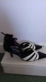 Black and white high heel shoes
