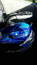 Two motocross helmets wulfsport and thh makes