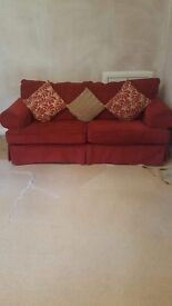 2 sofas 1 2seater 1 3seater red in colour
