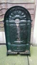 Cast iron tap outdoor water feature