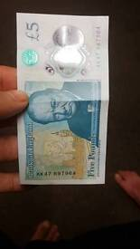 New £5 note with AK47 number
