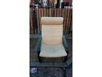 black wood framed chair with cream leather look seat