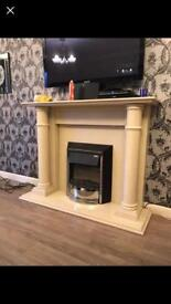 Marble fire place and electric fire