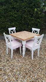 Table and Chairs with cushions in very good condition.