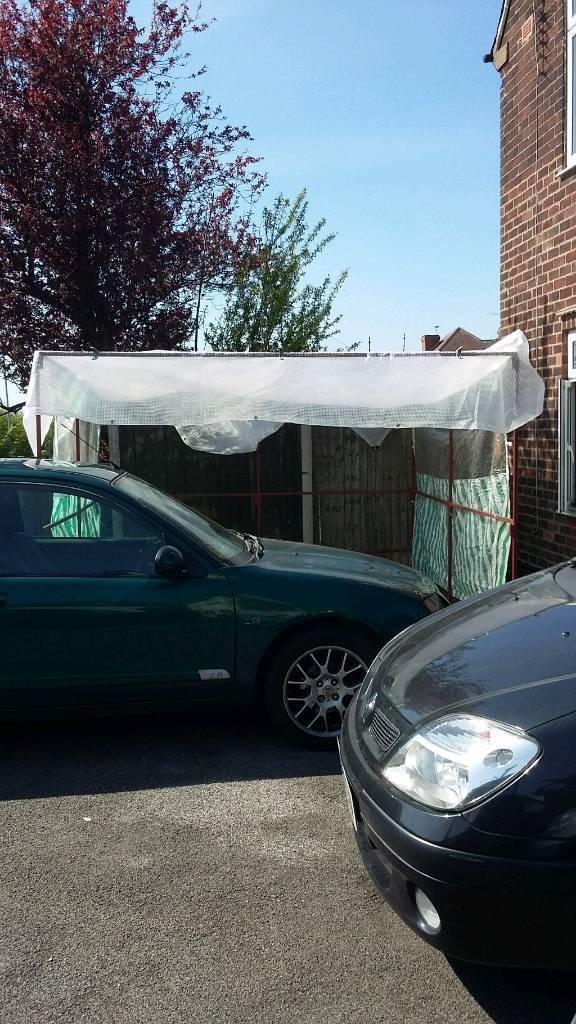 A market trader stall with tarpaulin sheets