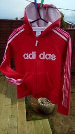 Bright pink Adidas hooded top for girls