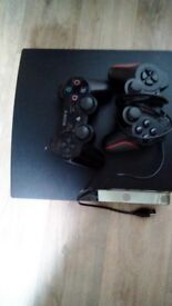 Ps3 with 26 games and 2 controllers