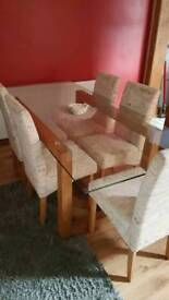 Solid oak & glass table , with 6 chairs