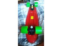 Nearly new penny board red deck with lime green wheels never been outside the house