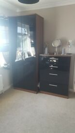 Black high gloss wardrobe with matching 4 drawer chest.
