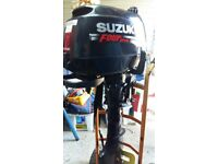 Suzuki 6 long shaft outboard engine, manual, tool kit, cover, and bracket