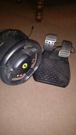 Xbox 360 thrust master steering wheel and pedals, boxed.