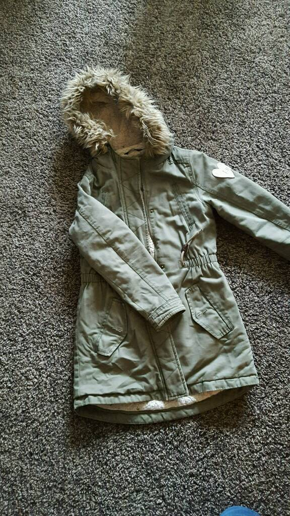 Girls coat from George 910 yrsin Biggleswade, BedfordshireGumtree - Girls lovely fully lined coat from George in khaki green. Fur trim is removable. From pet and smoke free home OOS