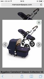 Bugaboo Cameleon V2collection Navy Blue & cream with brown leather handles.