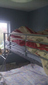 """Double (4'6"""") bed with single on top metal with built in ladder including 2 mattresses"""