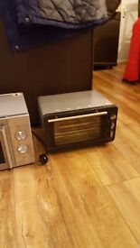 Microwave,mibi oven and moving trolley