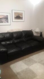 Beautiful 4 seater black leather sofa arm chair and storage foot stool