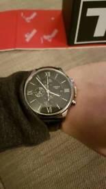 Tissot leather strap watch.