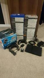 PS2 slim, 2xwireless pads, 60 games, steering wheel & peddles