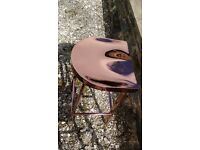Three stylish bar stools in copper-like finish