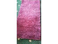 Purple bedroom rug.