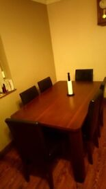 Wooden table with 6 leather chairs