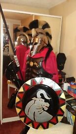 Spartan, Greek hopolite leather armour,with 2 helmets one polished steel the other Black