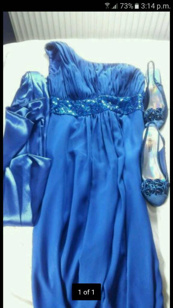 Dress for salein Norwich, NorfolkGumtree - Dress for sale in Norwich.Long blue sparkly zip up dress, with a blue wrap to go round your shoulders and a pair of shoes.Dress size 10 and shoes size 5. All worn once and in good condition