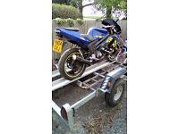 Blue Rieju 125cc motorcycle with 125 parts and a 50cc frame due original frame being breaker,