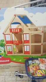 Wooden dolls house new in box