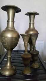 Brass vases 2 large ones and 2 small ones.