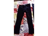 Pair of black trouser leggings size 12