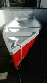 12.6 x 4 ft rowing punt, paddles, Rowlocks and a 2.5 hp suzuki outboard