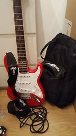 3/4 Electric Guitar by Fender in red, comes with amp, plugs and stand