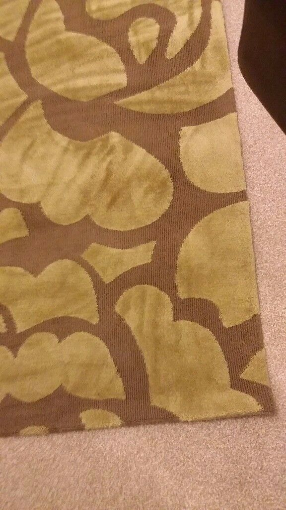 Lovely gold/brown rug nearly new 9ft x 6ft