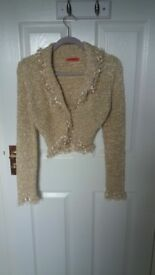 Lovely gold knotted shrug. Size s/m