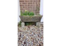 Solid stone decorative trough. Sits on 2 gargoyle stone stands. 85cm long by 45cms high