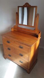 Wooden chest of draws with built in mirror .