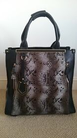 Travel/Cabin Bag by Mallisa J Collection in snake skin. Extendable handle with two wheels