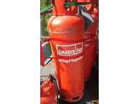 two or more empty largest red propane gas bottles £10 each